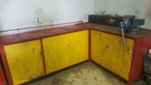 Heavy duty steel work bench with vise.