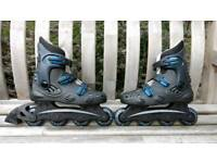 Ladies size 5 inline skates with wrist and knee pads - used once.