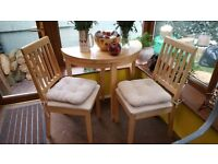 Small dining table and two chairs