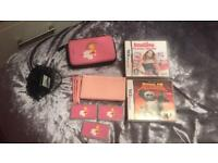 Pink Nintendo DS lite with case and two games