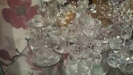 Two glass cabinets with lights also sworski crystals minitures and large ones