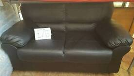 black leather effect 2 seater sofa