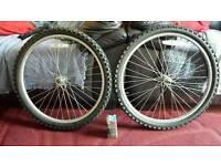 "2x 24 "" front mountain bike wheels plus spare inner tube ( new )"