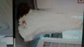 Ivory Wedding Dress size 14/16. Strapless, laced back with dimontè detail at the top. Needs cleaning