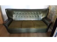 Deep forest green retro sofa with 70's styling
