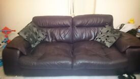 Two leather sofas deep puple colour