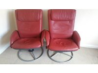 2 red leather recliner chairs