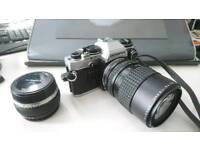 Olympus OM-10 SLR camera with standard and zoom lens