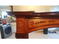 Fire surround, wooden, decorated