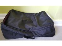 Black soft sided Tripp medium sized 2 wheel suitcase