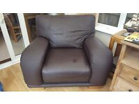 Chocolate brown leather armchair with oak feet.