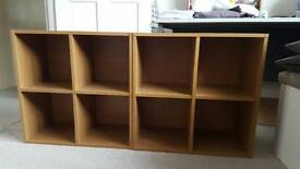Set of two stackable cube shelves.