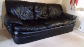 Black Leather Suite (3 seater + 2 seater +1 armchair + footstool)