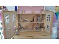 Large wooden dolls house with furniture and people