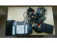 Sony PlayStation 2 with 2 controllers, buzzers and bundle PS2 games