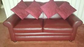 Two seater sofa one chair and a matching puffet