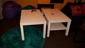 2 white Ikea coffee tables