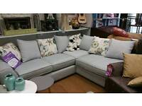 New pale blue corner sofa with floral scatter cushions