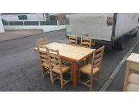 Solid pine table and 6 chairs in excellent condition £120 delivered