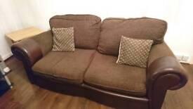 Two Piece brown sofa. BARGAIN