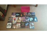 Joblot of 18 different Dvds with pink holder