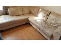 Reduced cream leather corner sofa and chair