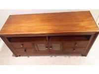 Solid Mango TV Cabinet with glass cupboard and 4 drawers. Excellent condition.