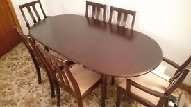 Excellent condition, dark wood, extending dining table with 6 chairs