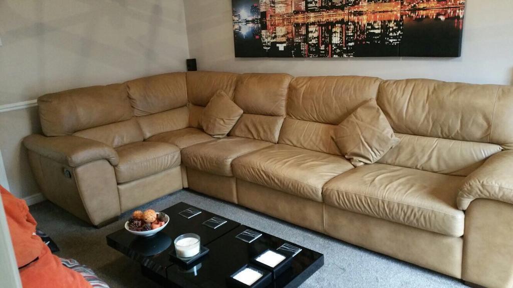 Light tan coloured corner settee
