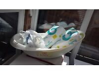 Baby bath and baby seat and nappies