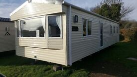 New static caravan for sale on 11 month site near beach in Torbay area . Subleting pack included