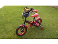 Child,s bike with stabilisers.