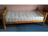 2 single pine beds, can be made into bunk beds. Mattress included.
