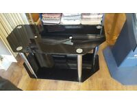 Black Glass TV stand (Good Condition) £30 Collection from Hall Green