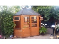 Used Hexagonal Shed/Kids playhouse. Base 246cm W x 175cm D. 2 front opening doors & windows