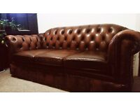 Chesterfield sofa and armchair. Original, in brown