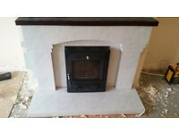White marble affect fireplace with mahoganey mantel and black inset multifuel stove