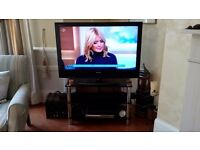 """Sony bravia 39"""" TV and glass and crome stand"""