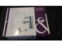 Basin mixer tap and pop up waste