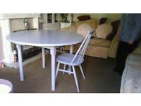 Solid pine dining table with 4 Ercol vintage chairs