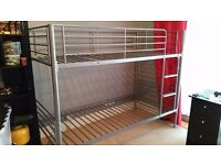 Silver/grey metal bunk beds