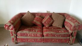 3 seater sofa with Egyptian pattern fabric .