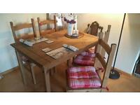 Wooden dinning table and 4 chairs very good condition