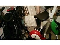 Exercise bike for sale red in colour