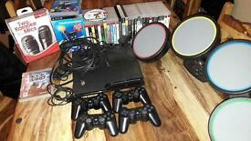 PS3 Bundle, play station motion, set of two mics, 42 games including FIFA 7/8/9/11/12