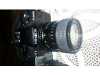 Minolta X-300s camera with 28-70 zoom lens, with bag, needs repair