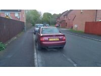 Audi A4, 1.8 Petrol Dark Red, 130k miles 1999 4 door. Good boot. Electric windows, remote locking.