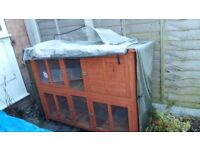 Bluebell hutch for sale including waterproof cover and accessories.