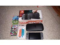 Nintendo Switch Bundle inc Zelda, Splatoon 2, joy con protectors and case