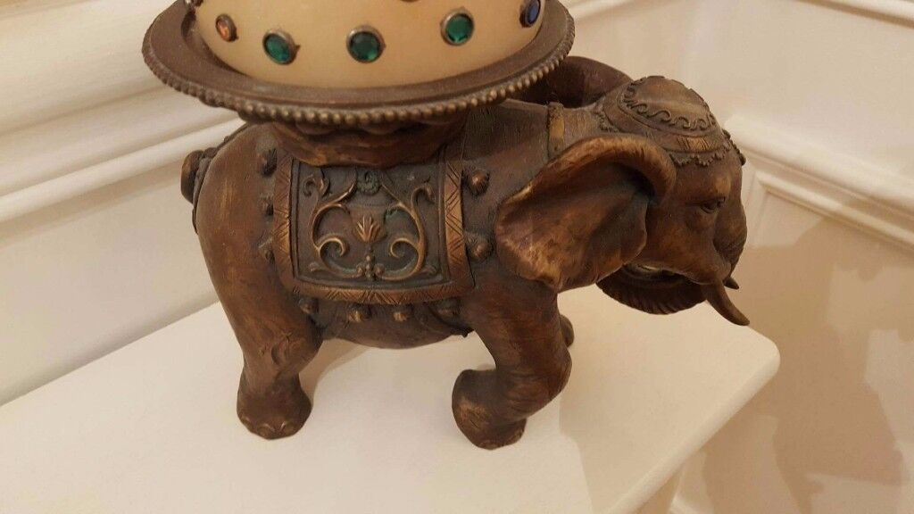 pair of carved elephant candle holders